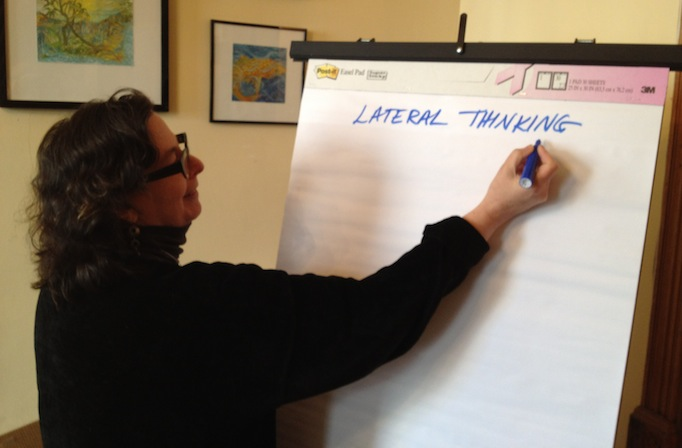 Liz Dreyer of EmcArts prepares for our lateral thinking exercises.